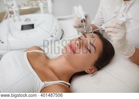 Close Up Of A Woman Relaxing At Cosmtology Parlor, While Getting Facial