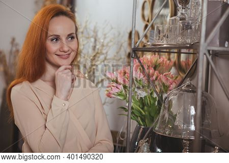 Lovely Mature Woman Smiling Thoughtfully, Shopping For Home Goods At Furnishings Store. Beautiful Fe