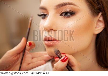 Cropped Shot Of A Beautiful Woman Getting Professional Makeup. Unrecognizable Makeup Artist Doing Li
