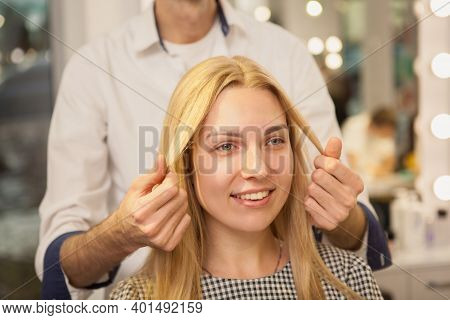 Cropped Close Up Of A Beautiful Happy Blond Haired Woman Enjoying Hair Care Treatment At Beauty Salo