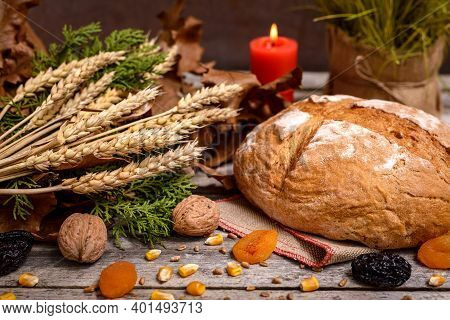 Traditional Food For Orthodox Christmas Eve. Yule Log Or Badnjak, Bread, Cereals, Dried Fruits And B