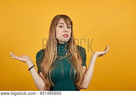 Wide Open Arms, Incredulity, Doubt Beautiful Woman. Is Surprised Spread Palms, Mimic And Facial Expr