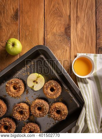 Homemade Baked Apple Cider Donuts On Baking Tray, Textile Napkin, Cider And Apple On Wooden Table. R