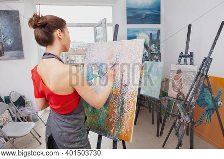 Rear View Shot Of Unrecognizable Female Artist Working On A Painting At Art Class, Copy Space