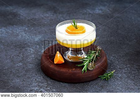 Dessert, Vanilla Panna Cotta With Tangerine Layer In A Small Portioned Vase On A Dark Concrete Backg
