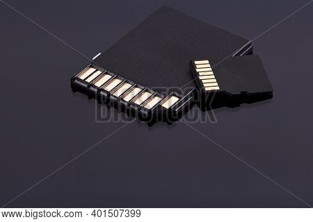 Micro And Sd Storage Memory Cards Isolated On Black Background. Different Storage Technologies.