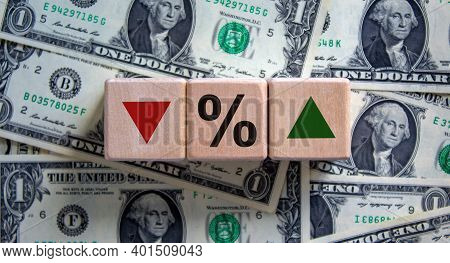 Change Of Interest Rates Symbol. Wooden Cubes With Opposite The Direction Of An Arrow Symbolizing Th