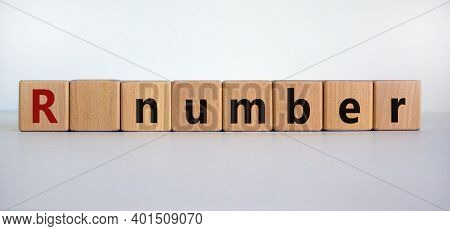 R - Reproduction Number Symbol. Wooden Cubes With Word R - Reproduction Number On Beautiful White Ba