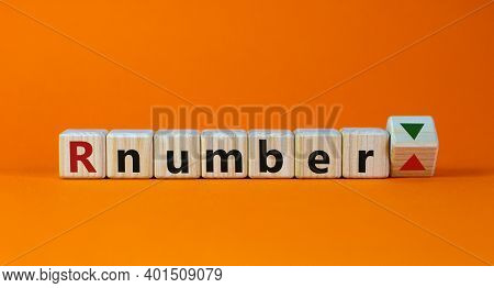 R - Reproduction Number Up Or Down Symbol. Wooden Cubes With Word R - Reproduction Number On Beautif