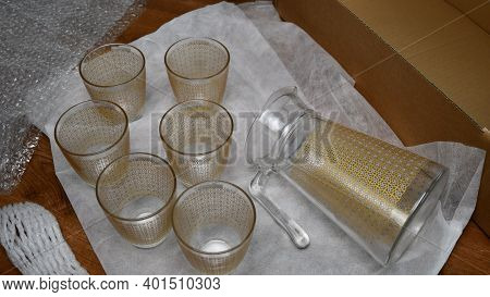 Pack Up Breakable Fragile Glassware Into Wrapping Bubble Plastic For Preparation To Move In New Home