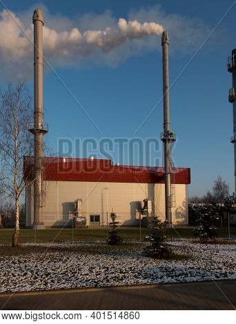Emission Measurements On A Chimney Discharging Wet Flue Gases From A Biomass Boiler With A Condensat