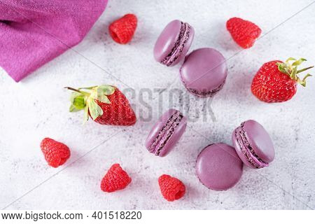 Berries Macarons With Cream Filling And Fresh Strawberries And Raspberries