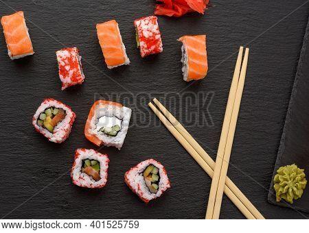 California Sushi With Red Tobiko Caviar And Slices Of Philadelphia Sushi On Black Slate Board, Top V