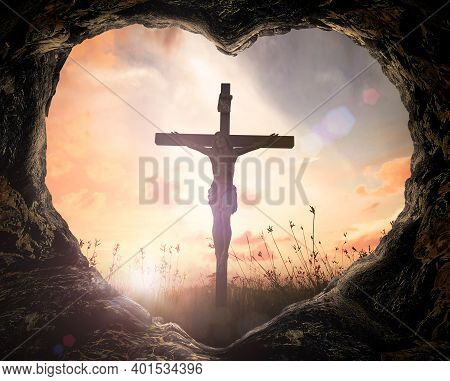 Resurrection Of Easter Sunday Concept: Heart Shape Of Cave With Jesus Christ On Cross Over Meadow Su
