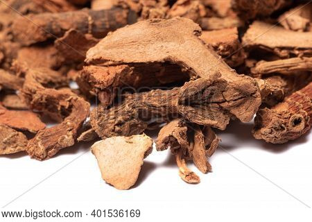 Lesser Galangal, Latin Name Alpinia Officinarum Dried Roots Heap Close-up View On White Background
