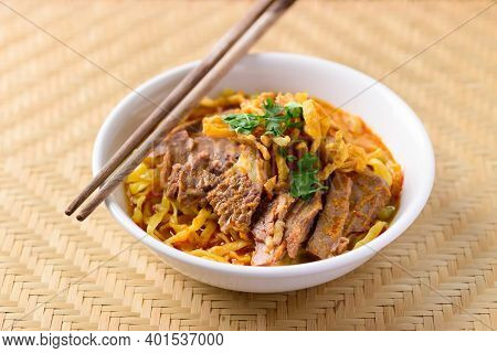 Northern Thai Food (khao Soi), Spicy Curry Noodles Soup With Beef In A Bowl And Chopsticks