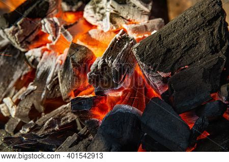 Close Up Of Charcoal Is Starting To Burn In The Kitchen Grill.  Hot Charcoal And Flame With Smoke.