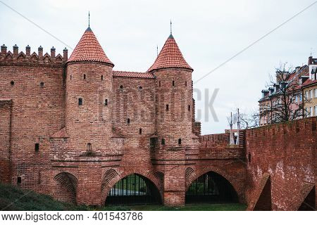 View Of The Walls Of The Ancient Castle At The Entrance To The Old Town And The Town Square In Warsa