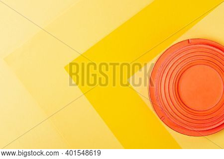 Clay Target For Skeet Shooting Against The Colorful Yellow Background. Clay Pigeon Shooting. Copy Sp