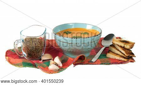 Pumpkin Soup With Croutons And Onions On The Colorful Plaid Tablecloth Isolated On A White Backgroun
