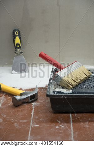Construction And Painting Tools Lie On The Floor During The Repair And Restoration Of The House.work