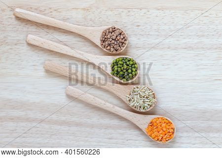Wooden Spoons With Different Grains. Rice, Moong Beans, Dal And Buckwheat. Healthy Food.