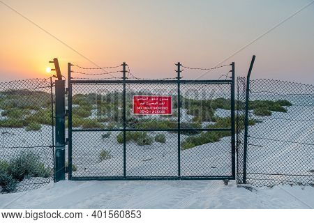 Abu Dhabi, Uae - July 7, 2020: Fence And Closed Gate To The Beach With Red Sign No Authorized Beach