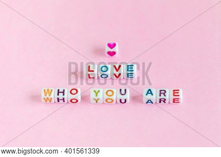 Quote Love Who You Are Made Out Of Beads On Pastel Pink Background