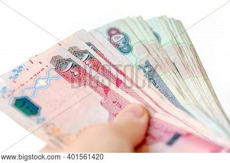 Stack Of Uae Dirhams In Woman's Hands. Banknote Of 100 And 500. Closeup.