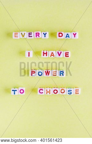 Quote Every Day I Have Power To Choose Made Out Of Beads On Pastel Yellow Background