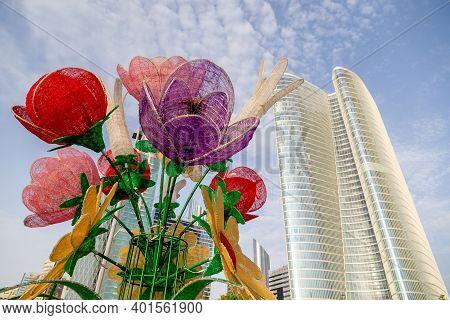 Abu Dhabi, United Arab Emirates - July 26, 2020: Flower Decoration On Corniche In Abu Dhabi With Mod