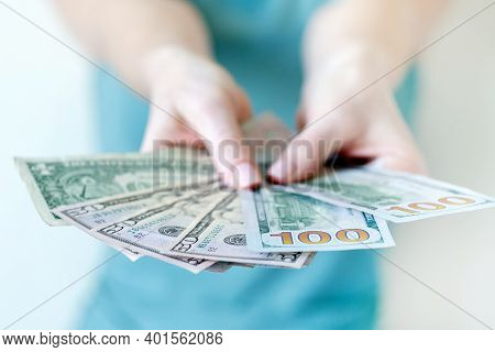 American Dollars In Hands. Hundred And Fifty Dollar Bills.