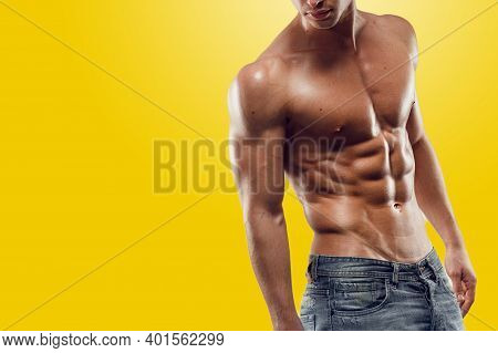 Athletic Young Man Shirtless, Showing Six Pack Abs, Relief Press, Isolated On Yellow Screen Chrome K