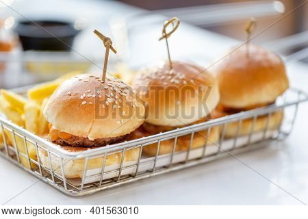 Mini Burgers With French Fries Served At The Bar, Finger Food, Closeup
