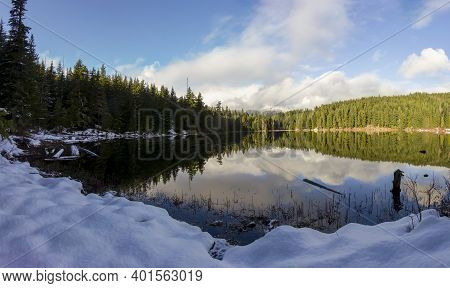 Beautiful Panorama Landscape Photo Of Lost Lake. Winter Scene, With Snow. Perfect Reflection Of The
