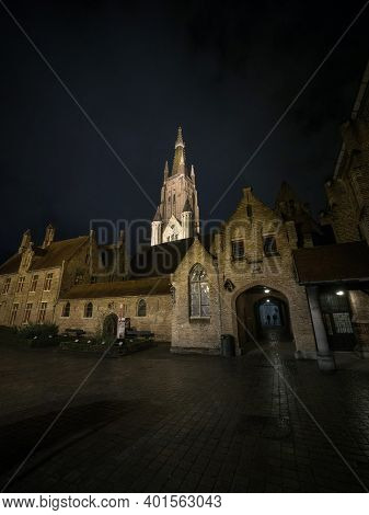 Panoramic View Of Illuminated Roman Catholic Gothic Cathedral Church Of Our Lady Onze Lieve Vrouweke
