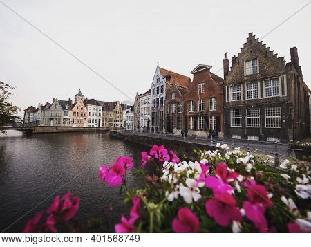 Panoramic View Of Flowers Decoration At River Canal Channel In Historic City Center Of Bruges West F