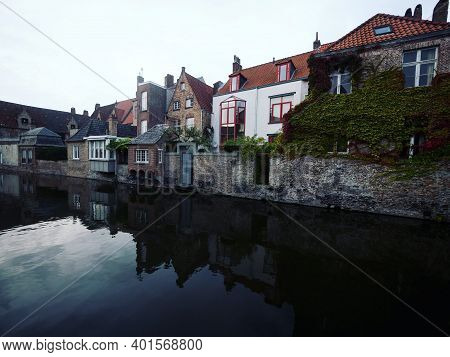 Panoramic Reflection View Of River Canal Channel In Historic City Center Of Bruges West Flanders Fle