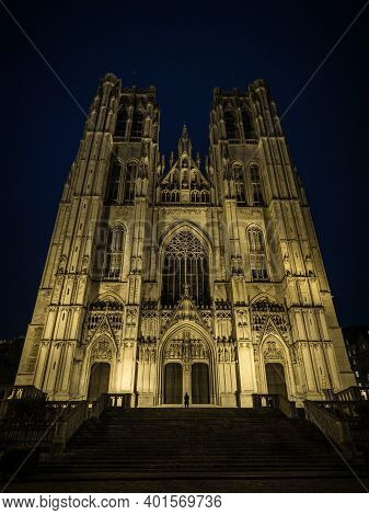 Person Infront Of Illuminated Facade Of Brabantine Gothic Roman Catholic Church Cathedral Of St Mich