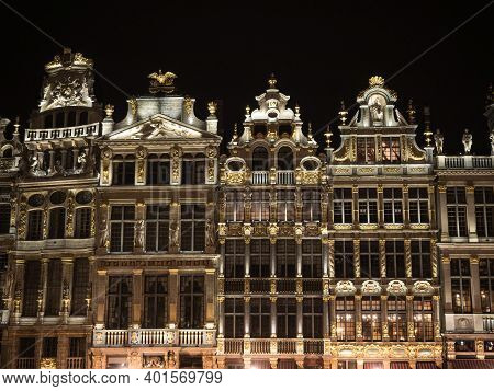 Illuminated Facade Of Historic Buildings At Grand Place Grote Markt Central Main Square In Capital B