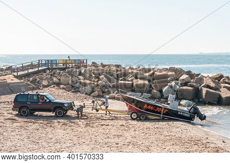 Swakopmund, Namibia - June 20, 2012: A Fishing Boat Being Loaded On A Trailer At The Molen In Swakop