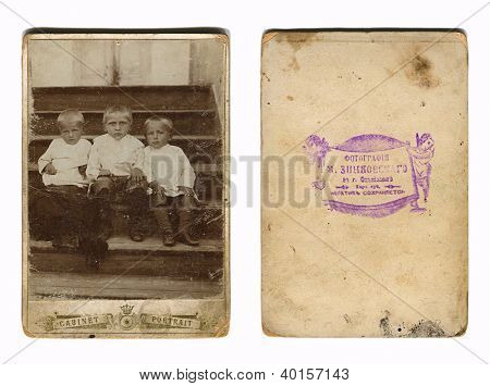 RUSSIAN EMPIRE - CIRCA 1880: Vintage photo of a group children, and its downside, circa 1880.