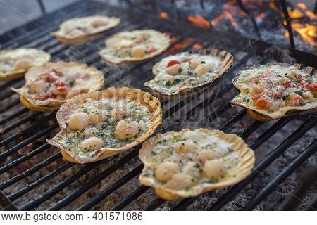 Detail Of Cooking On The Grill Of Scallops With Smoke