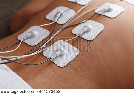 Muscle Stimulator With Electrodes, Bacback And Shoulder Massage With A Muscle Stimulator With Attach