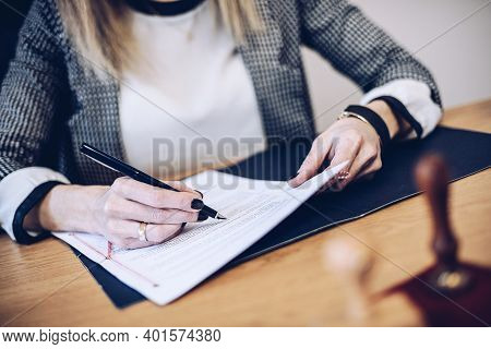 Hand Notary Woman Signing Legal Or Insurance Document.