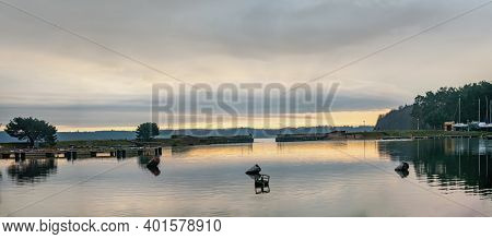 Panoramic  Landscape With Gate In A Harbour On A Rainy And Hazy Winter  Evening. Lithuania, Kaunas.