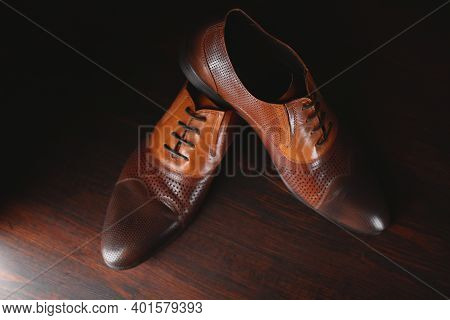 Male Brown Shoes Standing On The Wooden Floor Background