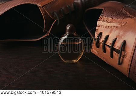 Stylish Mens Shoes And Perfume On Brown Background
