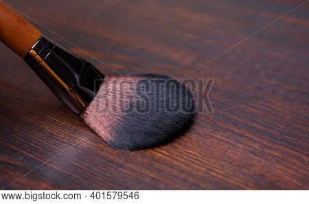 Makeup Brush On A Wooden Brown Background