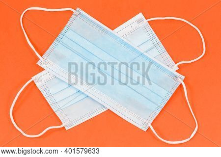 Some Surgical Masks Isolated On Orange Background